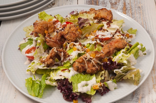 Salad with grilled chickenwarm salad with deepfried chicken greens corn and tomatoes