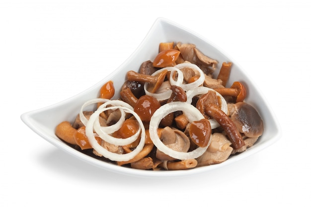 Salad with marinated mushrooms and onions isolated