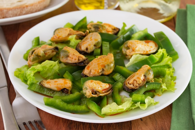 Salad with mussels on the plate