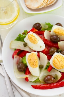 Salad with olives and boiled egg