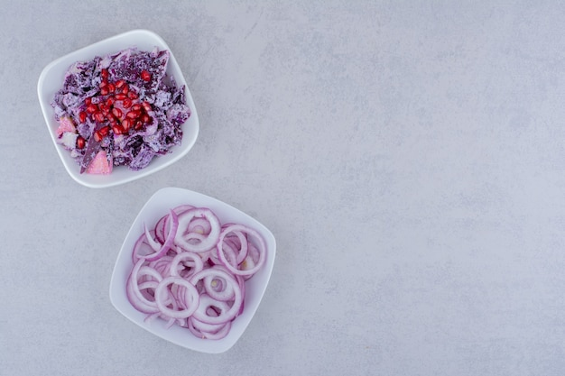 Salad with purple cabbage and onion in a plate