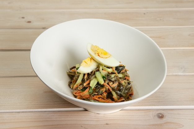 Salad with sea kale, carrot and egg