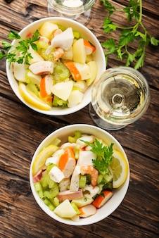 Salad with seafood, potato and celery