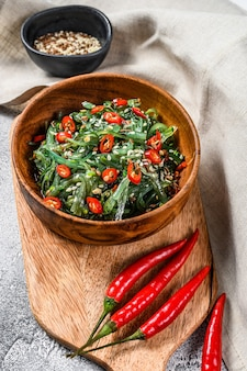 Salad with seaweed wakame and red chili pepper