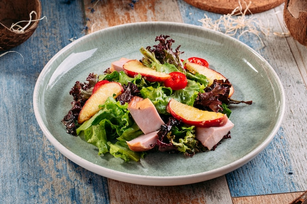 Salad with smoked turkey breast and apples