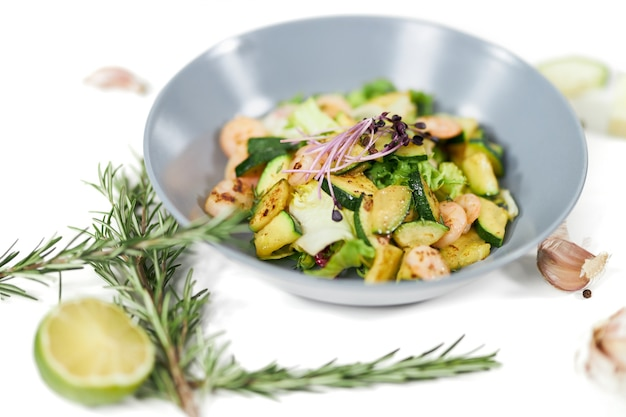 Salad with tasty juicy shrimps and zucchinigarlic