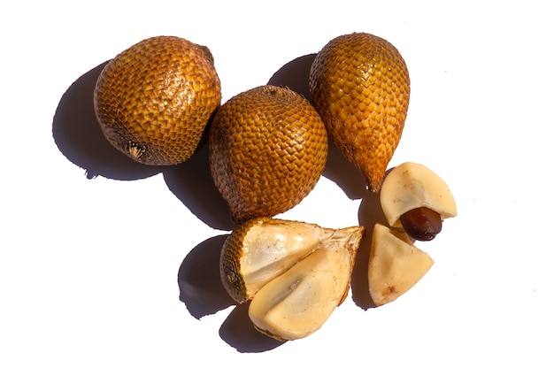 Salak gading (salacca edulis or salacca zalacca) known as snake fruit or snake skin fruit, a species of palm tree native to java island in indonesia, isolated on white background.