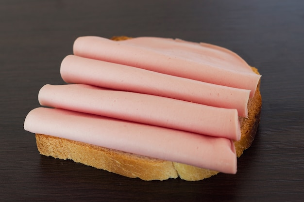Salami sandwich. open sandwich of salami slices on bread.