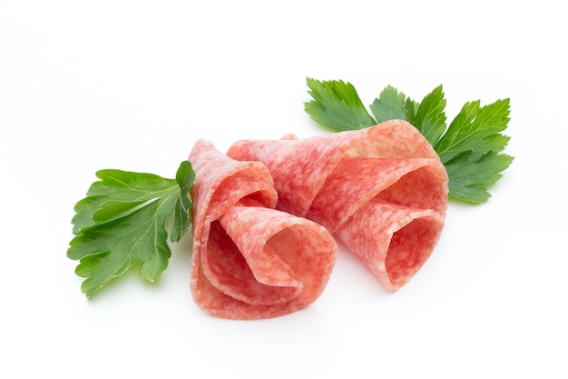 Salami sausage slices isolated on white