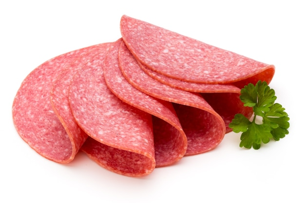 Salami slices isolated on the white surface.