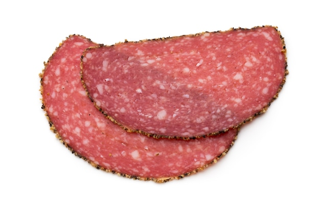 Salami slices isolated on white