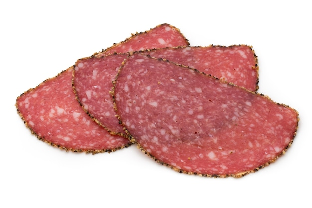 Salami slices isolated on white.