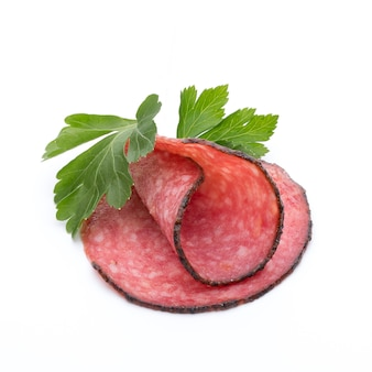 Salami slices and parsley