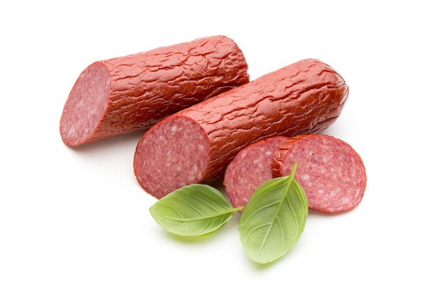 Salami smoked sausage, basil leaves isolated