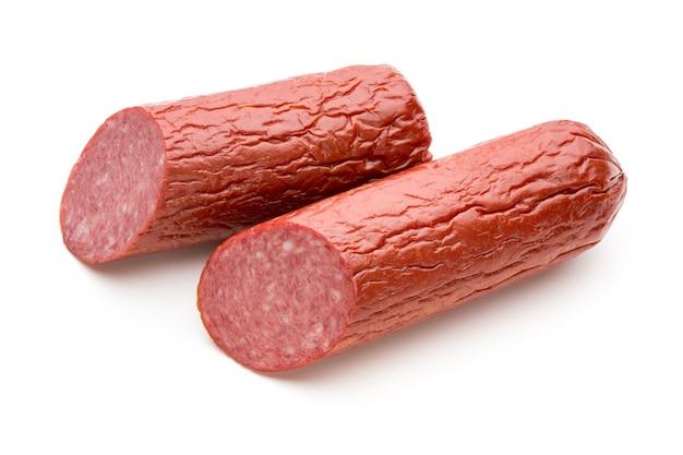 Salami smoked sausage, basil leaves on white.