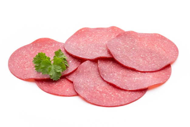 Salami smoked sausage one slice isolated on white surface cutout.