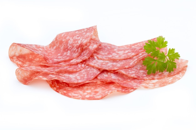 Salami smoked sausage slices isolated on white background cutout.