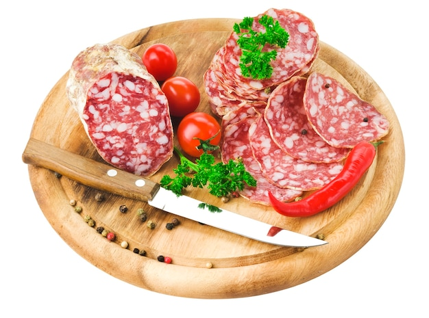 Salami, tomatoes, chili pepper and parsley leaves with knife
