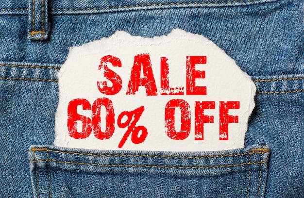 Скидка 60 на белой бумаге в кармане джинсов