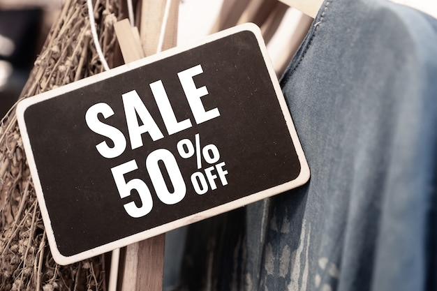 Sale advertise display frame on clothes line at shopping department store