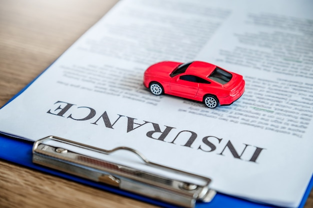 Sale agent giving car to customer and sign agreement contract, insurance car .