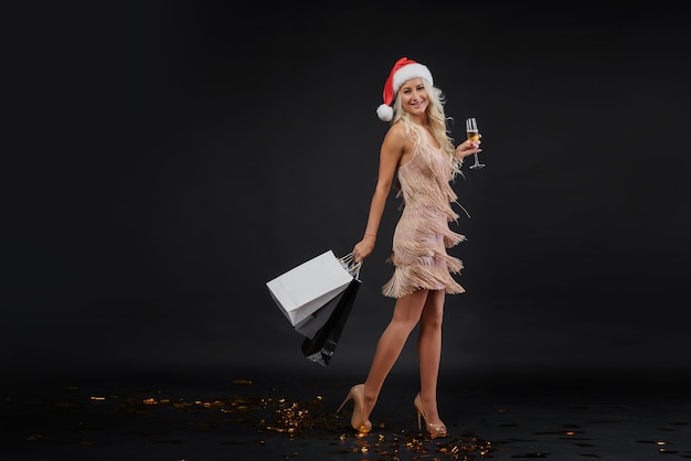 Sale concept. woman in luxury dress and santa hat celebrating christmas