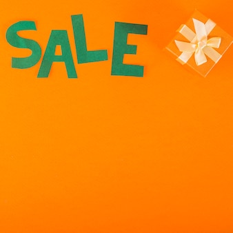 Sale lettering of paper with gift box