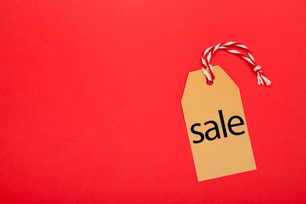Sale price tag with ribbon top view
