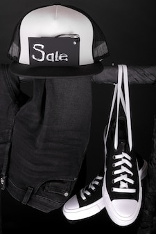 Sale sign. black and white sneakers, cap  black friday. close up.