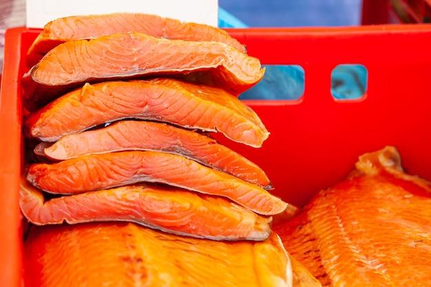 Sale of smoked kamchatka fish. far eastern seafood, natural smoked fish - chinook salmon at the city christmas market.