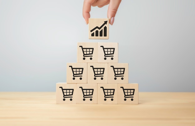 판매 볼륨 증가로 비즈니스 성장 아이콘 그래프 및 쇼핑 카트 기호가 있는 플립 큐브