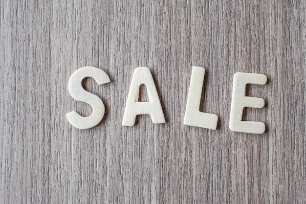 Sale word of wooden alphabet letters. business and idea concept