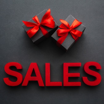 Sales concept with presents on black background