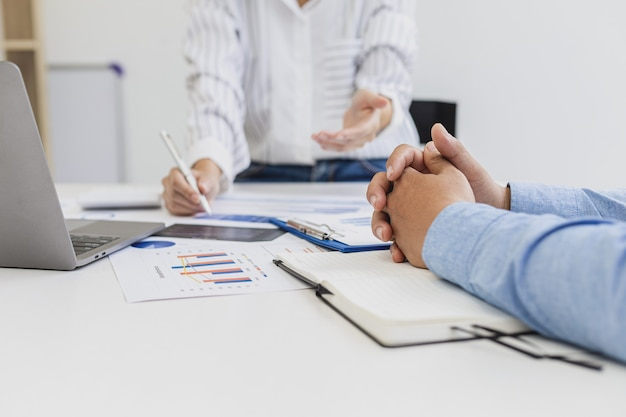 The sales department is having a monthly summary meeting to bring it to the department manager, they are verifying the correctness of the documents that are prepared before bringing in to the manager