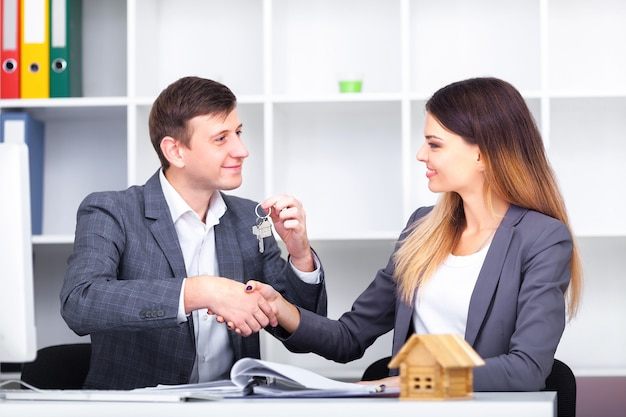 Sales manager giving advice to his couple clients