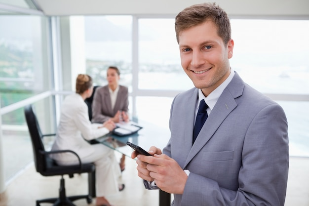 Sales manager holding cellphone