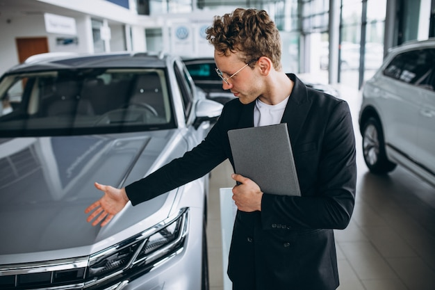 Salesman at a car showroom