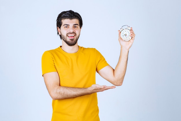 A salesman holding and promoting the alarm clock.