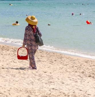 中国のビーチのセールスマン。