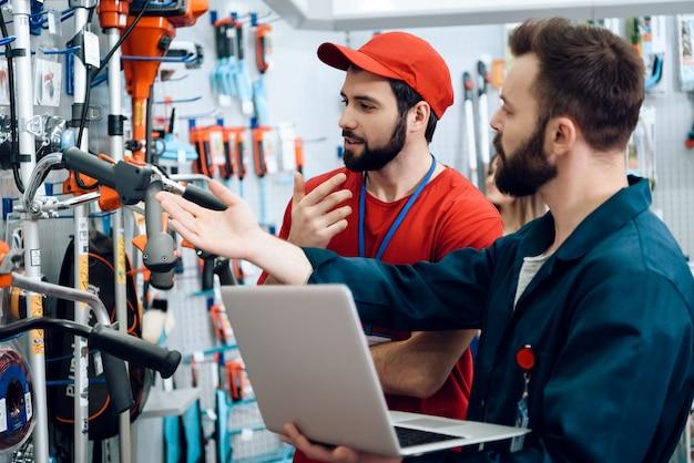 Salesmen is working in power tools store