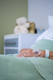 Saline on senior patients hand