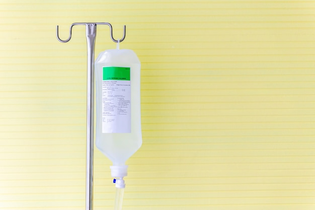 Saline solution fluid iv bag in emergency room at hospital.