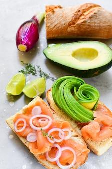 Salmon and avocado salad with arugula and lime. ketogenic food