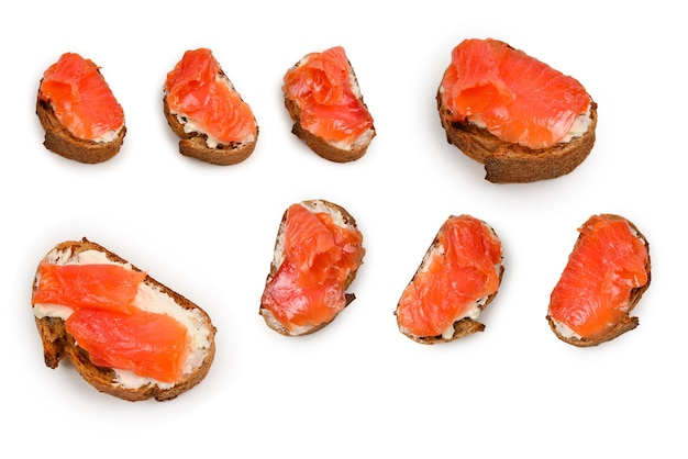 Salmon on a bread with cream isolated on white.