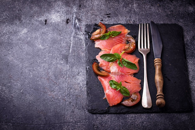 Salmon carpaccio with basil and tomato