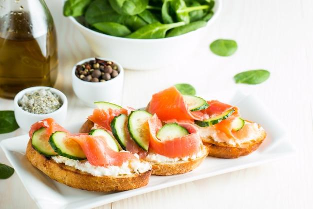 Salmon, cucumber and cream cheese bruschetta.