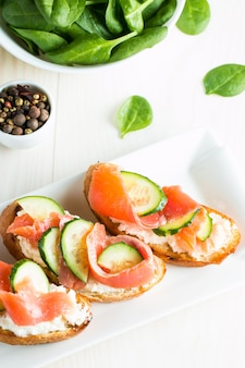 Salmon, cucumber and cream cheese bruschetta.