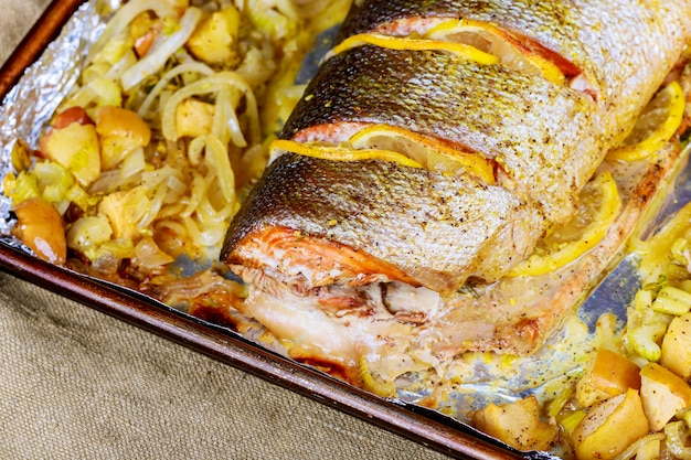 Salmon fillets baked in oven served with vegetables