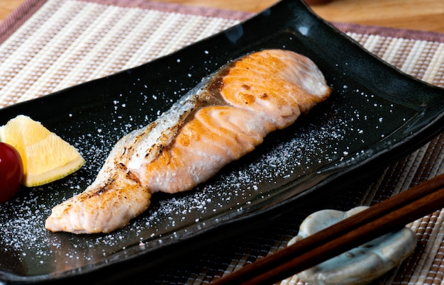 Salmon grilled with salt in japanese style .