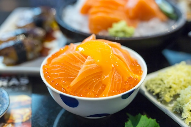 Salmon ikura donburi with salmon roe and egg yolk